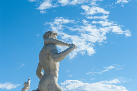 olympic symbol: Rome, Italy - August 6th 2016. Fighter statue at Stadium of the Marbles with blue sky background Editorial