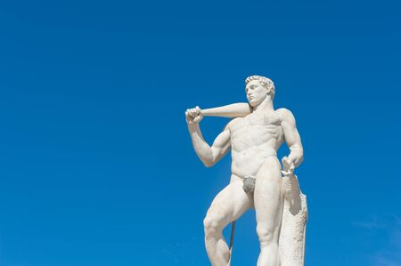 Rome, Italy - August 6th 2016. Fighter statue at Stadium of the Marbles with blue sky background Editorial