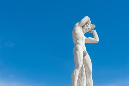 discus: Rome, Italy - August 6th 2016. Discus thrower statue at Stadium of the Marbles with blue sky background Editorial
