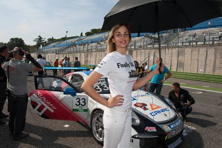 carrera: Vallelunga, Rome, Italy. September 10th 2016. Porsche Carrera Cup, grid girl and car on starting line