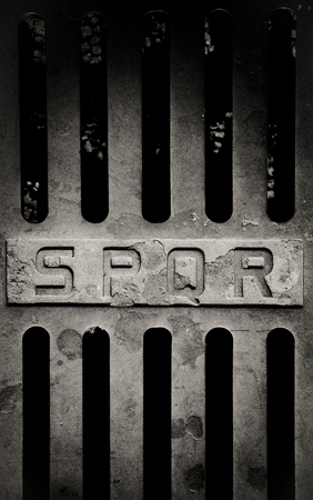 street signs: Iron old roman manhole cover detail with spqr sign