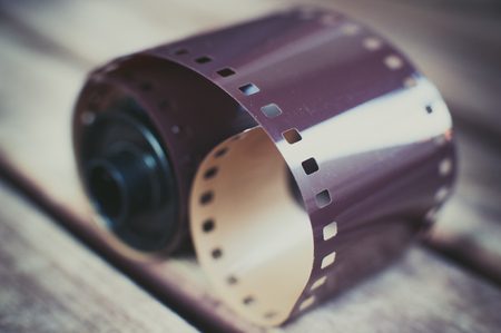 negative film: Detail of dusty vintage photographic roll and unexposed negative film selective focus