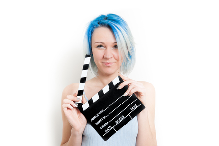 audition: Teen alternative girl smiling and posing isolated on white background with movie clapper board for actress audition