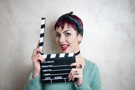 actress girl: Young alternative girl smiling face and posing with movie clapper board for actress audition