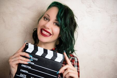 actress girl: Young alternative girl smiling face posing with movie clapper board for actress audition Stock Photo