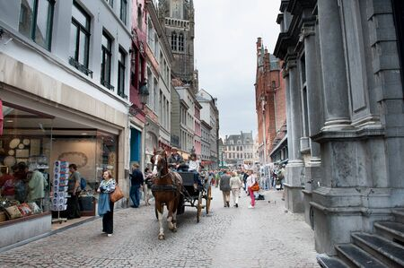 horse cart: Bruges, Belgium - August 7 2012. City street with people and typical horse cart walking around in daytime