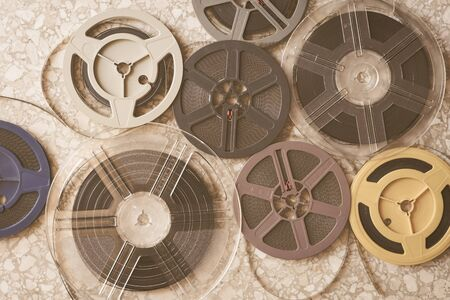 Background of many different aged super 8 mm movie reels, vintage colors