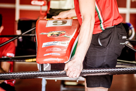 Vallelunga, Rome, Italy. June 24 2017. Italian Formula 4 championship, Prema Power Team car in pit workshop, mechanic working on nose shell detail Editorial