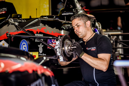 Vallelunga, Rome, Italy. June 24 2017. Italian Formula 4 championship, Bhaitech team car in pit workshop, mechanic working on brake pad