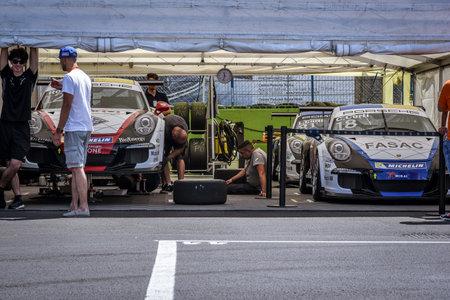 carrera: Vallelunga, Rome, Italy. June 24 2017. Mechanic working on car engine before Italian Porsche Carrera Cup race in garage workshop