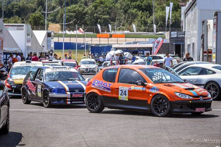 racetrack: Vallelunga, Rome, Italy. June 24 2017. Italian Super Cup championship cars in the paddock waiting for pit lane entry, orange peugeot 206 first place