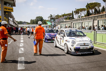 Vallelunga, Rome, Italy. June 25 2017. Trofeo Abarth Selenia, cars in pit lane waiting for green flag, marshal and people in pit