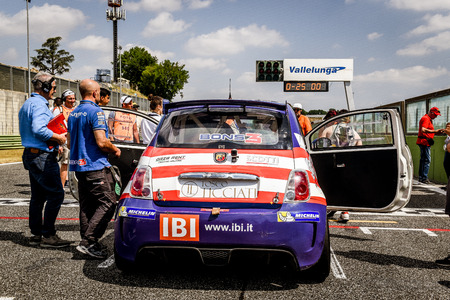 Vallelunga, Rome, Italy. June 25 2017. Trofeo Abarth Selenia, Fiat 500 cars on starting grid with people around in pole position line, view from behind