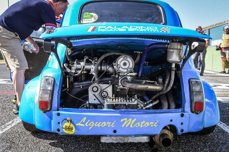 racetrack: Vallelunga, Rome, Italy. June 24 2017. Italian Bicilindriche Cup, Blue Fiat 500 racing car on starting grid rear view with engine detail