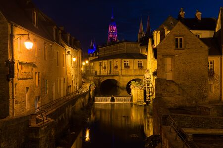 Bayeux by night. The mill on the Aure river Stock Photo