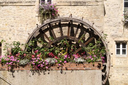 Mill wheel decorated with geranium flowers
