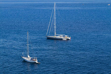 tyrrhenian: a series of sailing boats sailing in the calm waters of the Tyrrhenian Sea