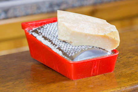 cheese grater: Parmesan cheese grater in the kitchen Stock Photo