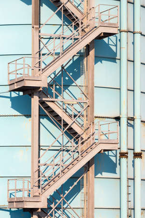to go up: old iron stairs go up on silos