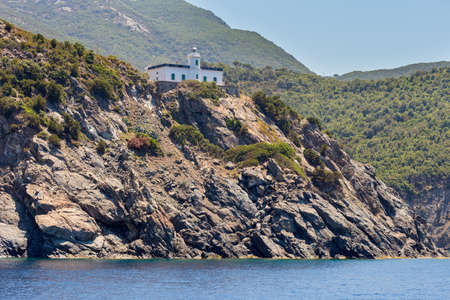 guides: ancient lighthouse that guides the boats along the coast