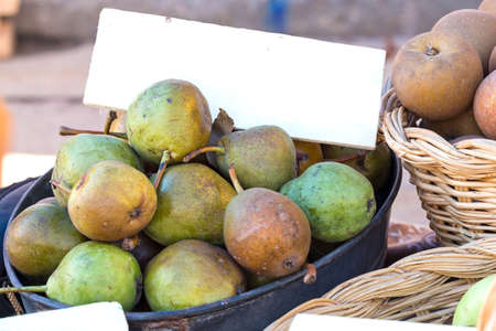 ancient pears on market stall Stock Photo