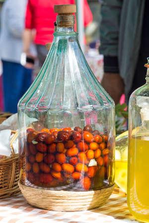bottle full of fruit in alcohol