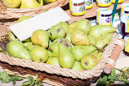basket of pears for sale at the market