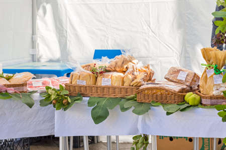 large basket of bread and biscuits on the stand