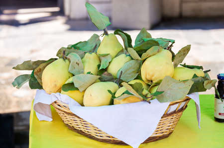 yellow pears in a basket on the table