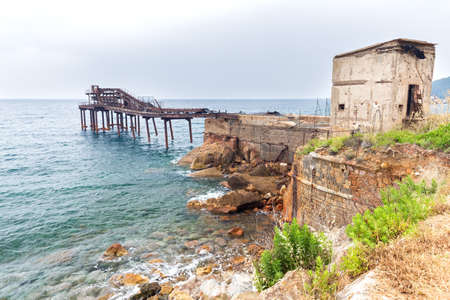 old abandoned pier on the cliff