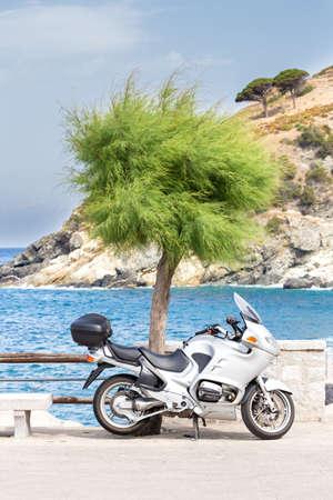 beautiful gray motorbike parked near the rocks