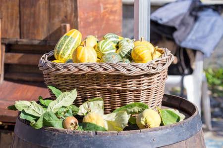basket full of vegetables over the barrel