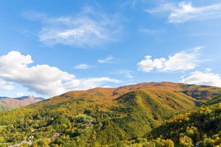 white clouds covering hills multicolor