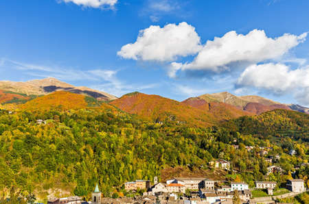 mountain town surrounded by autumn colors