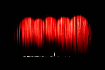 theatre: Red curtain of movie theater closed illuminated by 5 spot lights