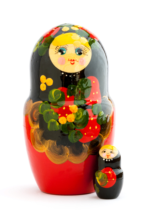 matrioska: Two closed traditional russian matryoshka dolls on white background