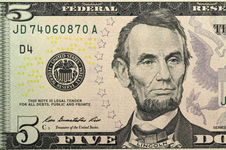 New banknote five dollars closeup