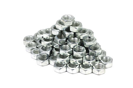 anodized: Metal nuts laid pyramid on a white background Stock Photo