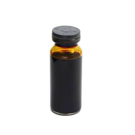 a vial with a solution of iodine isolated on white