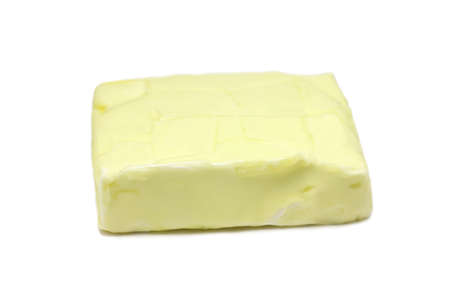 yellow butter on a white background photo