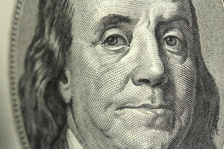 buy one: One hundred dollar bill closeup Stock Photo