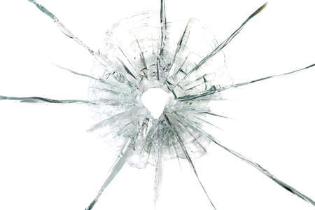 penetration:  large bullet hole in glass abstract background Stock Photo