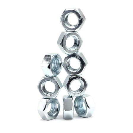 anodized: shiny anodized hex nuts on white background