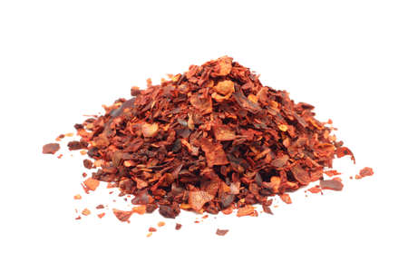 red paprika pulverized on a white background Imagens