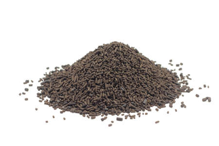 catalyst: a handful of brown granules of catalyst on a white background Stock Photo