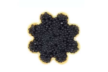 a little black caviar in tartlets on white background photo