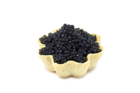 black caviar in tartlets on white background photo