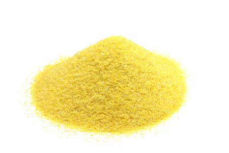 handful of yellow corn flour on a white background