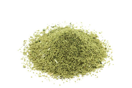 granulated seasoning for food on a white background