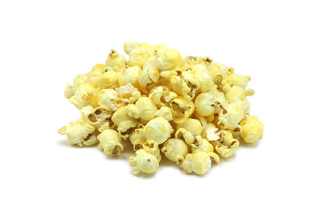 a handful of popcorn on a white background